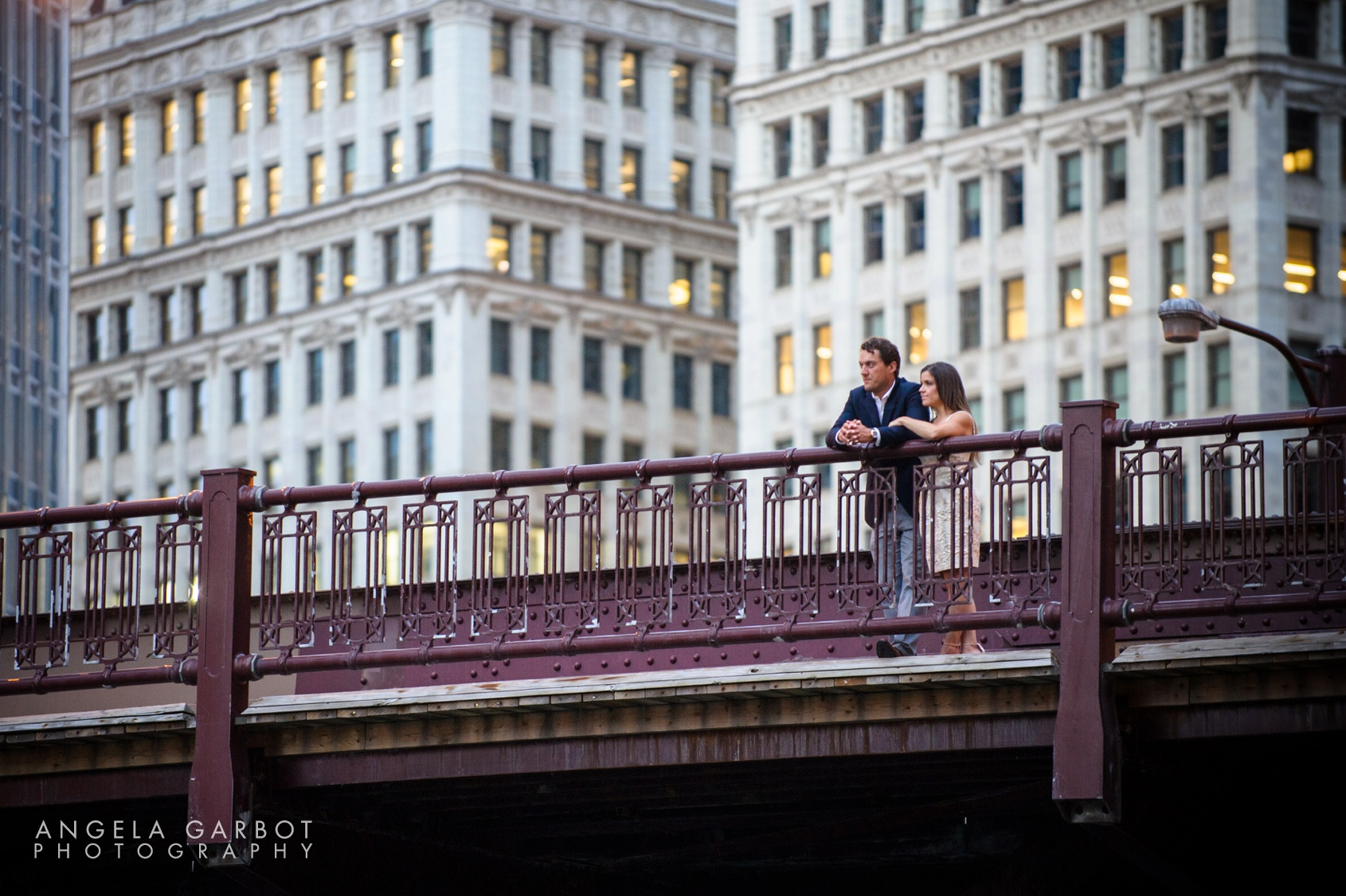 Chicago pre-wedding engagement session along the Riverwalk and the Wrigley Building in downtown Chicago.
